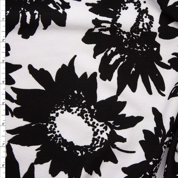 Black Sunflowers on White Crepe Textured Liverpool Knit Fabric By The Yard