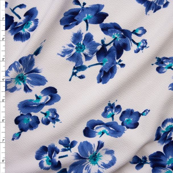 Blue, Black, and Turquoise Hibiscus Floral on White Crepe Textured Liverpool Knit Fabric By The Yard
