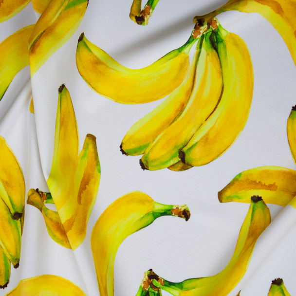 Tossed Bananas on White Premium 5.8oz Nylon/Spandex Fabric By The Yard
