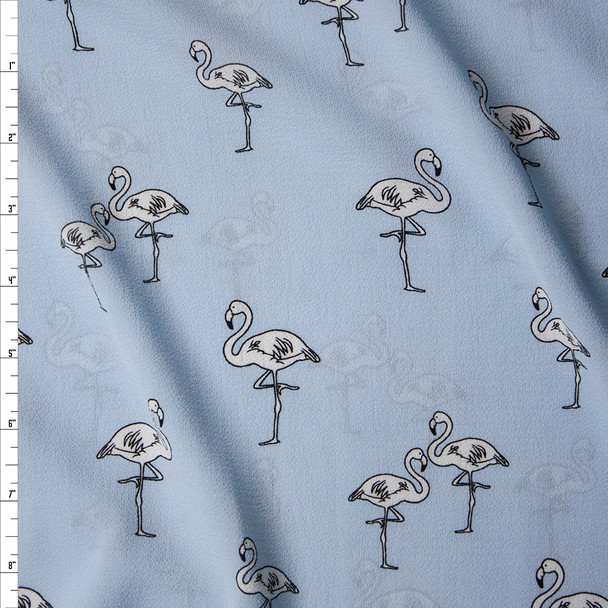 White Flamingos on Light Blue Bubble Crepe Fabric By The Yard