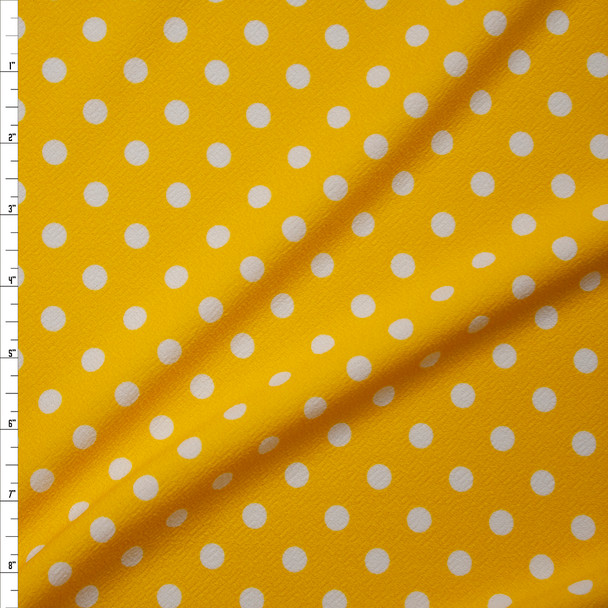 White on Yellow Polka Dot Crepe-Like Liverpool Knit Fabric By The Yard