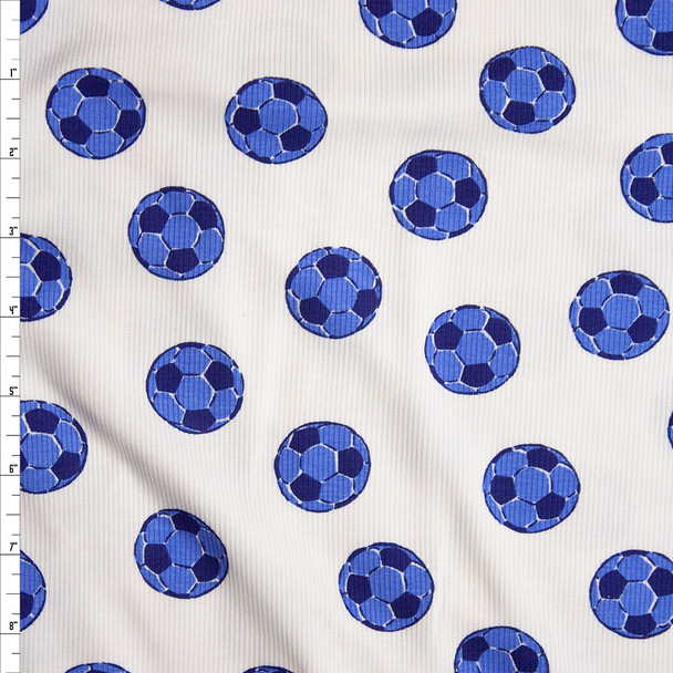 Blue Soccer Balls on White Lightweight Stretch Cotton Ribbed Knit Fabric By The Yard