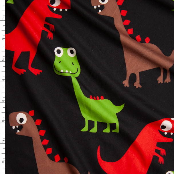 Red, Brown, and Green Dinosaurs on Black Brushed Poly Spandex Knit Fabric By The Yard