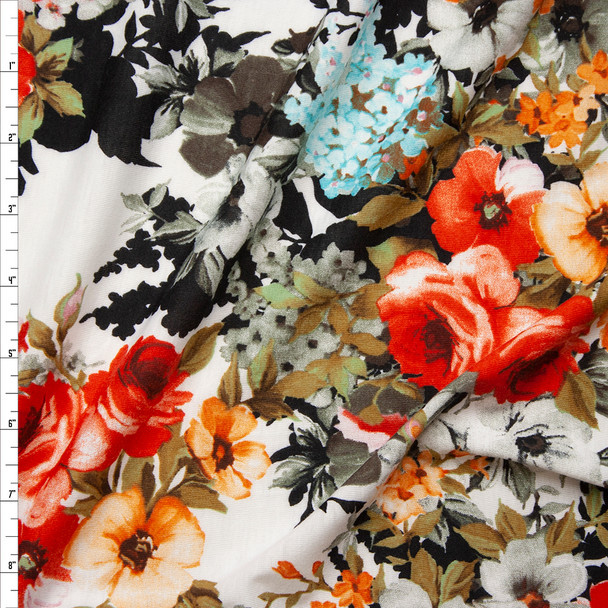 Red Orange, Blue, Black, and White Floral Jersey Knit Fabric By The Yard