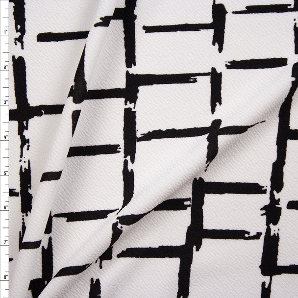 Black Grunge Grid on White Crepe Liverpool Knit Fabric By The Yard