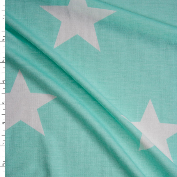 Large White Stars on Mint Green Poly/Rayon French Terry Fabric By The Yard