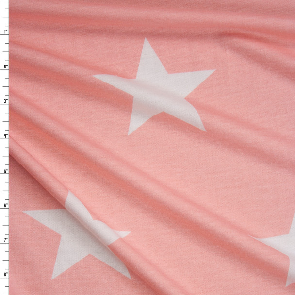 Large White Stars on Pink Poly/Rayon French Terry Fabric By The Yard