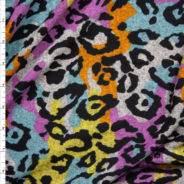 Black Leopard Print on Lilac, Light Blue, Mustard, and Grey Blotches Brushed Sweater Knit Fabric By The Yard