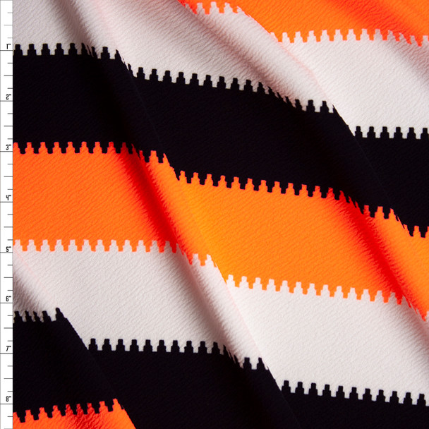 Neon Orange, Black, and White Crepe Textured Liverpool Knit Fabric By The Yard