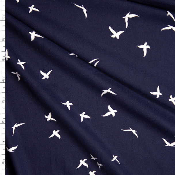 White Birds on Navy Blue Double Brushed Poly/Spandex Knit Fabric By The Yard