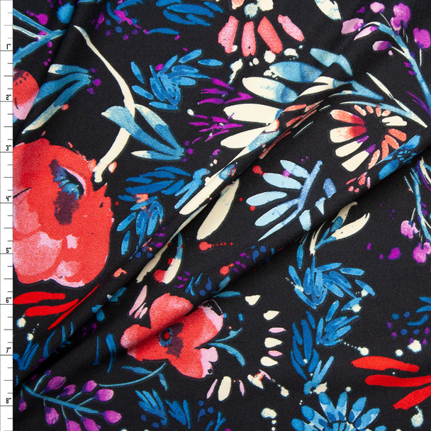 Red, Teal, and Plum Firework Floral on Black Poly/Spandex Knit Fabric By The Yard