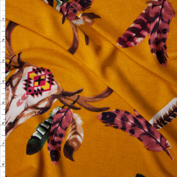 Feathered Deer Skulls on Mustard Soft Sweater Knit Fabric By The Yard