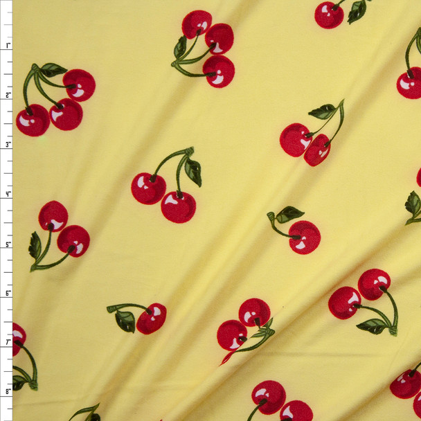 Cherries on Light Yellow Double Brushed Poly/Spandex Fabric By The Yard