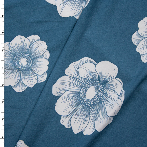 White Flowers on Slate Blue Double Brushed Poly/Spandex Fabric By The Yard