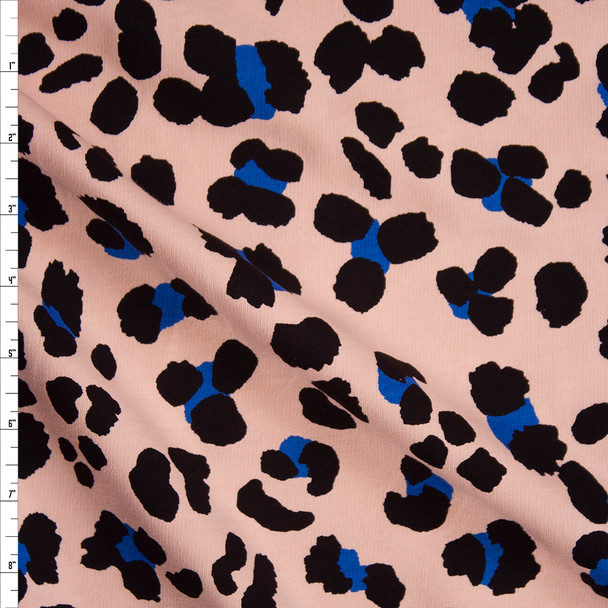 Black and Bright Blue Leopard Print on Peach Cotton French Terry Fabric By The Yard