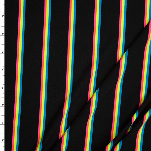 Neon Pink, Yellow, and Blue on Black Double Brushed Poly Fabric By The Yard