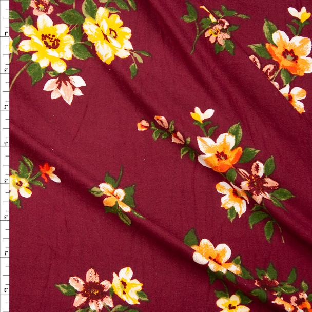 Orange and Yellow Wildflowers on Burgundy Double Brushed Poly Fabric By The Yard