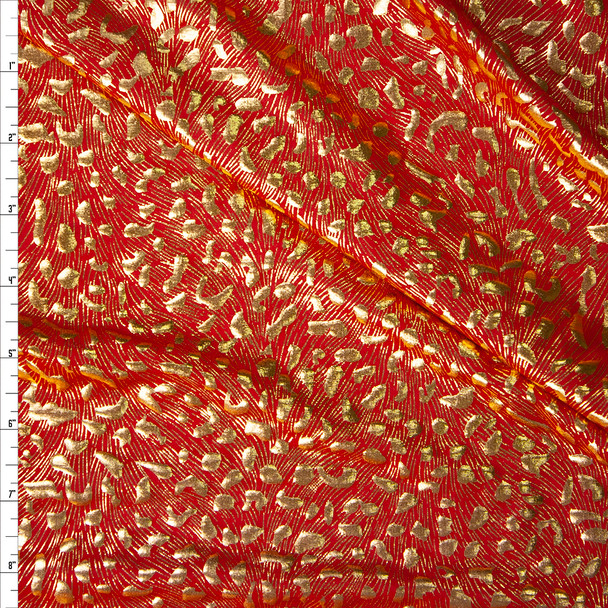 Gold Cheetah Metallic on Red Lightweight Nylon/Spandex Fabric By The Yard