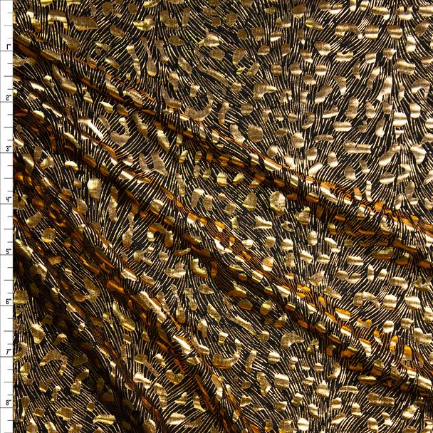 Gold Cheetah Metallic on Black Lightweight Nylon/Spandex Fabric By The Yard