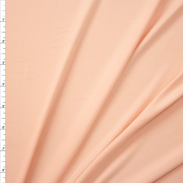 Light Peach Solid Double Brushed Poly Spandex Fabric By The Yard