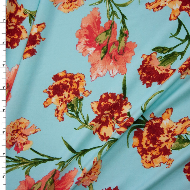 Orange and Coral Flowers in Robins Egg Blue Double Brushed Poly/Spandex Fabric By The Yard