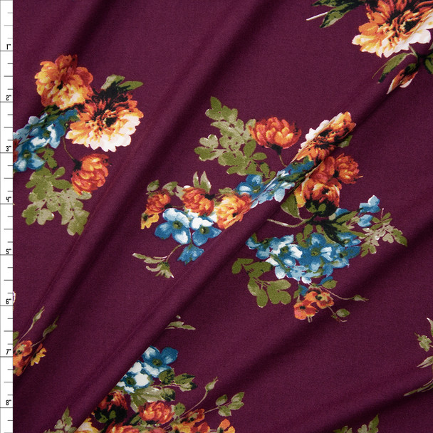 Orange and Blue Floral on Wine Double Brushed Poly/Spandex Fabric By The Yard