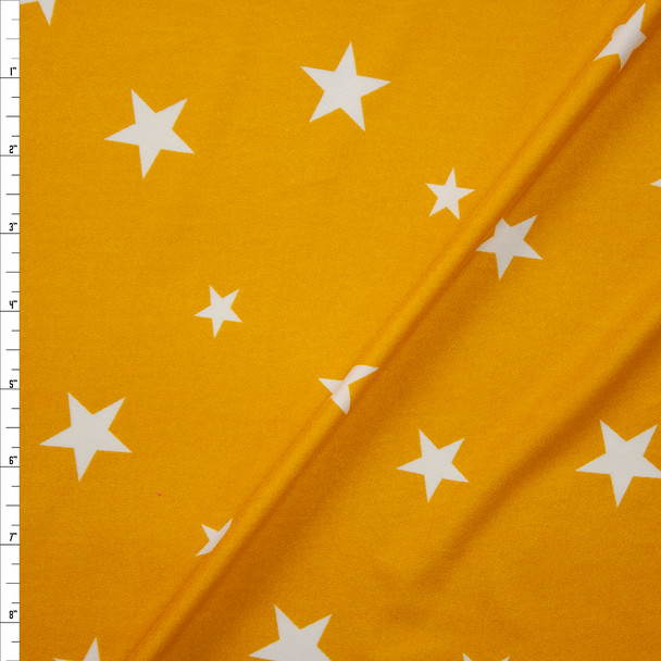 White on Mustard Stars Double Brushed Poly Spandex Knit Fabric By The Yard