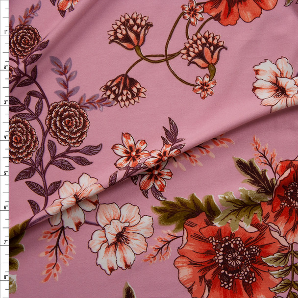 Scrolling Orange, Plum, and Green Floral on Pink Double Bushed Poly/Spandex Fabric By The Yard