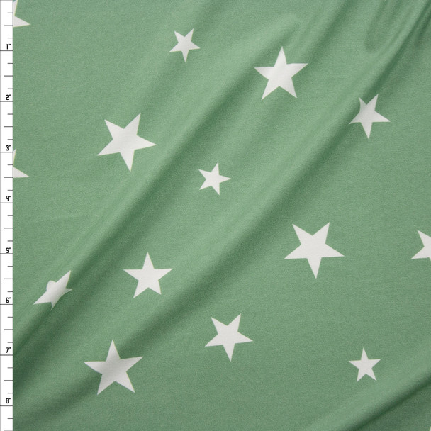 White Stars on Sage Double Bushed Poly/Spandex Fabric By The Yard