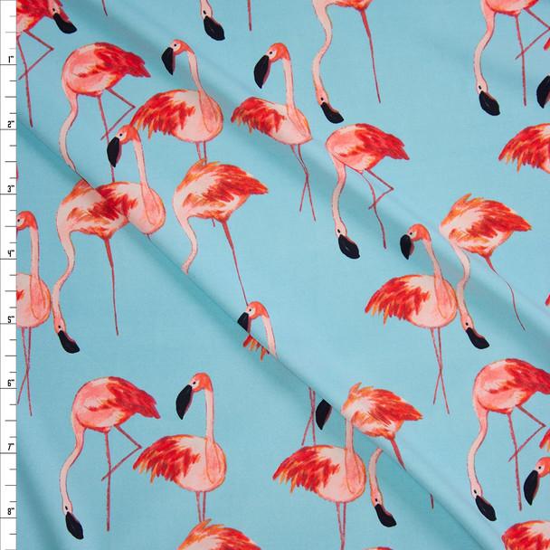 Pink Flamingos on Light Blue Nylon/Spandex from Manhattan Beachwear Fabric By The Yard