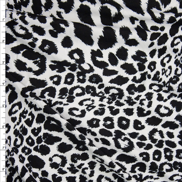 Black on White Mixed Leopard Double Brushed Poly/Spandex Knit Fabric By The Yard