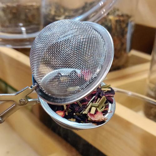 Tetång eller tekämma i rostrfritt på skaft. 45 mm.