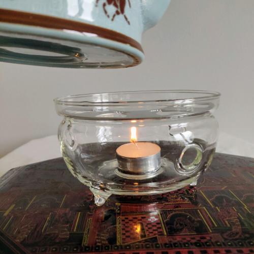 Tevärmare i glas för värmeljus, med topp i rostfritt