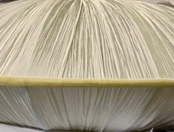 Details of the pleated silk white and creamy border.