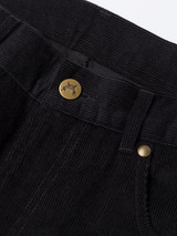 Close Up of Black Needle Cord Jeans Fabric and Button