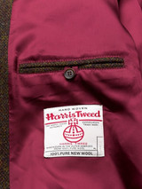 Close Up of Bronze Brown Harris Tweed Harrington Jacket Orb Logo