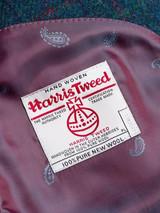 Close Up of Marine Blue Harris Tweed 3 Piece Suit Orb Logo