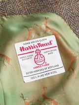 Close Up of Bracken Brown Harris Tweed Suit Jacket Orb Logo