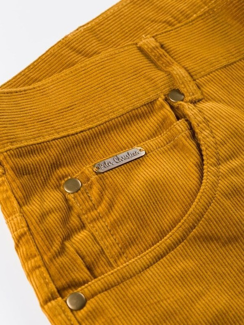 Close Up of Gold Yellow Needle Cord Jeans Fabric