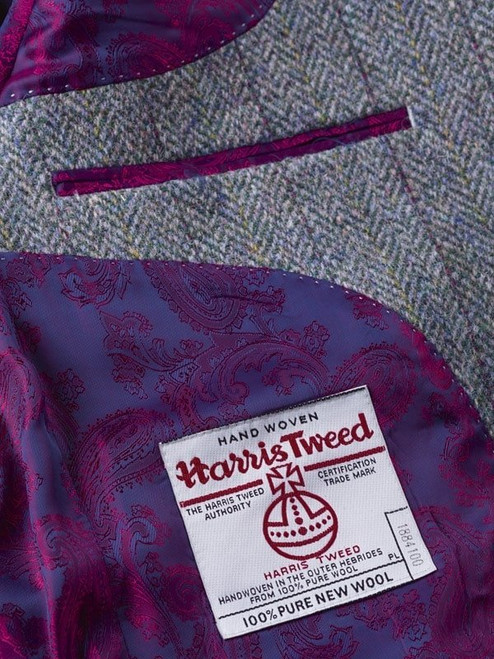 Close Up of Lovat Green Harris Tweed Jacket Orb Logo