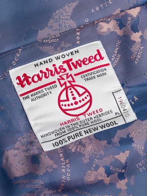 Close Up of Lovat Green Harris Tweed Waistcoat Orb Logo