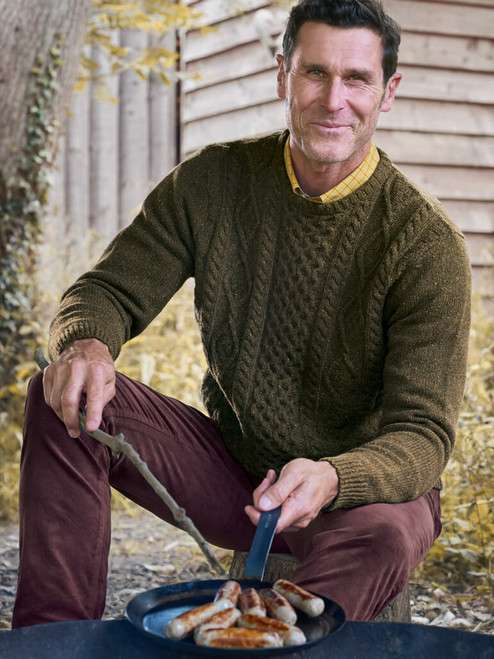 Model wears Moss Donegal Cable Knit Jumper