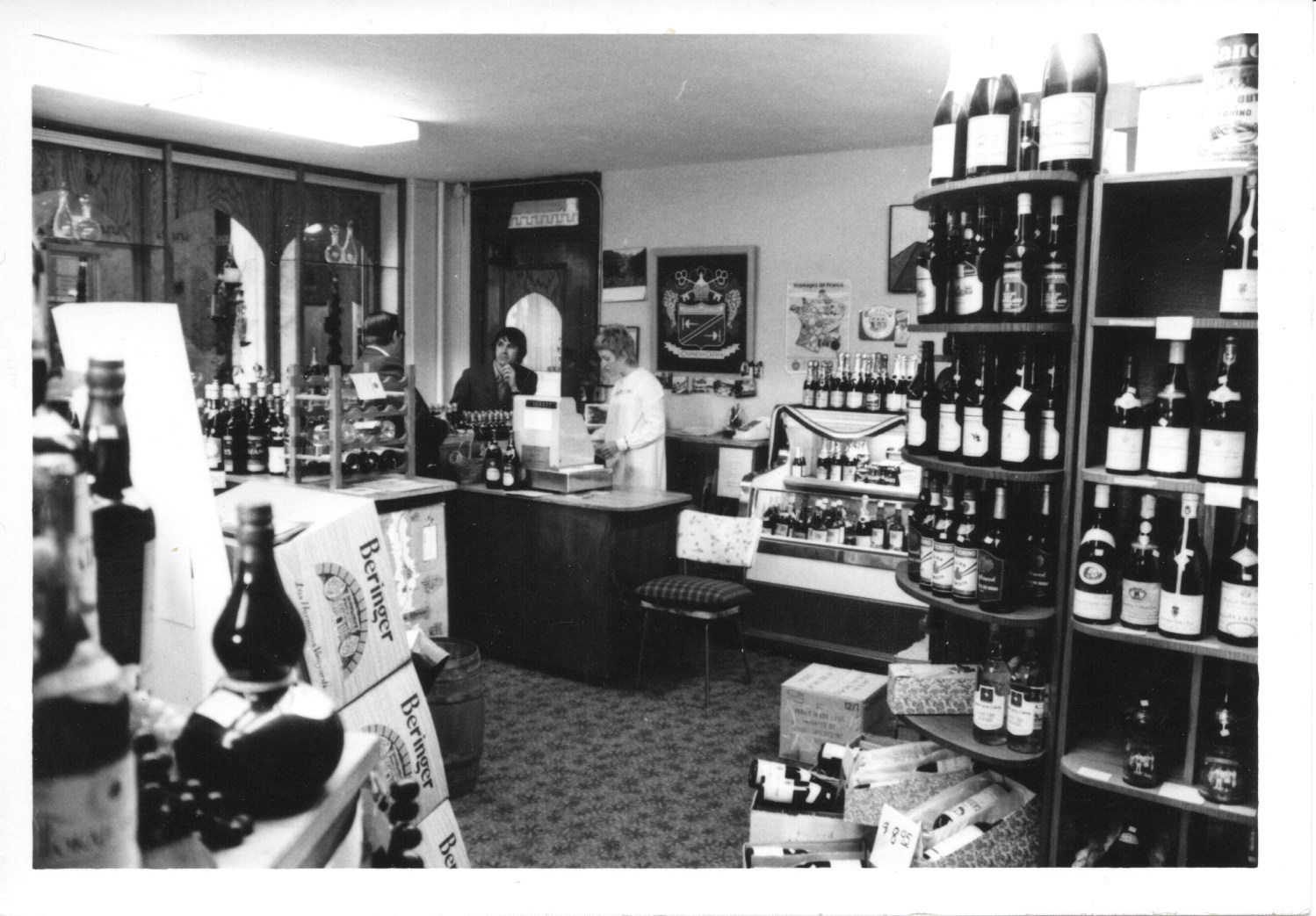 Emile Ninaud behind the counter at the first shop on 3rd and Marion