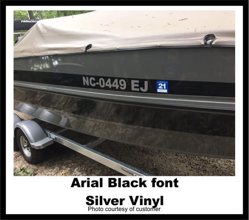 Boat registration decal on boat in Arial Black font and silver vinyl