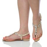Model wearing Gold PU Flat Slingback Diamante T-Bar Toe Post Sandals