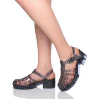 Model wearing Smoke Glitter Mid Heel Gladiator Jelly Sandals