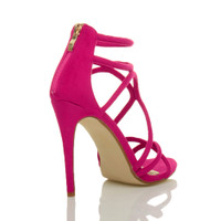 Back right side view of Fuchsia Pink Suede High Heel Strappy Crossover Barely There Sandals