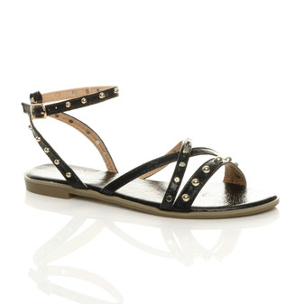 Front right side view of Black Flat Ankle Strap Studded Strappy Sandals