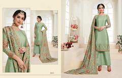 Cardamom Green color Chinnon Fabric Suit