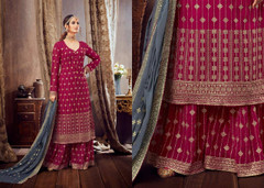 Magenta color Pure Georgette Fabric Heavily Embroidered Suit